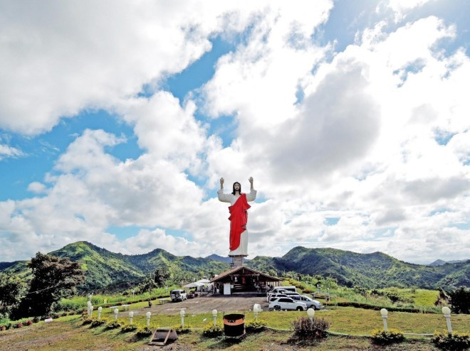 """A 132-foot statue of the Sacred Heart of Jesus watches over capital Roxas City, where the """"Aswang Festival"""" was also born."""